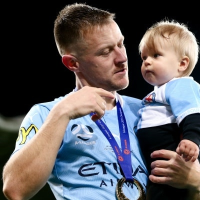 MELBOURNE, AUSTRALIA - JUNE 27: Scott Jamieson of Melbourne City takes his kid onto the field after winning the A-League Grand-Final soccer match between Melbourne City FC and Sydney FC on June 27, 2021 at AAMI Park in Melbourne, Australia. (Photo by Dave Hewison/Speed Media)