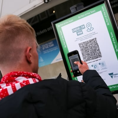 MELBOURNE, AUSTRALIA - JUNE 27: Spectators arriving at AMMI Park are seen checking in with the COVID QR code during the A-League Grand-Final soccer match between Melbourne City FC and Sydney FC on June 27, 2021 at AAMI Park in Melbourne, Australia. (Photo by Dave Hewison/Speed Media)