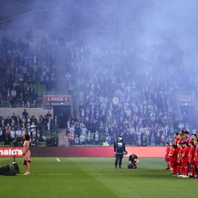 MELBOURNE, AUSTRALIA - JUNE 27: Players and soccer kids stand as the Australian Anthem is sung during the A-League Grand-Final soccer match between Melbourne City FC and Sydney FC on June 27, 2021 at AAMI Park in Melbourne, Australia. (Photo by Dave Hewison/Speed Media)