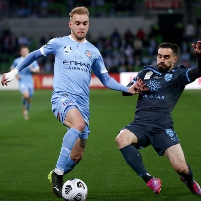 MELBOURNE, AUSTRALIA - JUNE 27: Nathaniel Atkinson of Melbourne City and Anthony Caceres of Sydney FC contest the ball during the A-League Grand-Final soccer match between Melbourne City FC and Sydney FC on June 27, 2021 at AAMI Park in Melbourne, Australia. (Photo by Dave Hewison/Speed Media)
