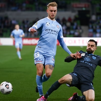 MELBOURNE, AUSTRALIA - JUNE 27: Nathaniel Atkinson of Melbourne City controls the ball ahead of Anthony Caceres of Sydney FC during the A-League Grand-Final soccer match between Melbourne City FC and Sydney FC on June 27, 2021 at AAMI Park in Melbourne, Australia. (Photo by Dave Hewison/Speed Media)