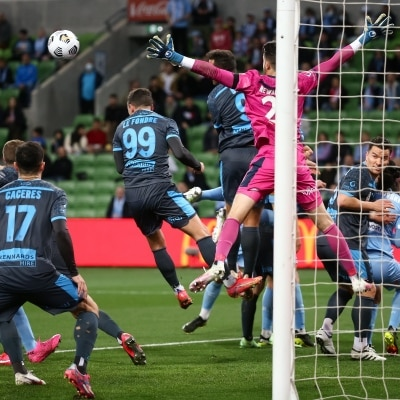 MELBOURNE, AUSTRALIA - JUNE 27: Adam Le Fondre of Sydney FC heads the ball during the A-League Grand-Final soccer match between Melbourne City FC and Sydney FC on June 27, 2021 at AAMI Park in Melbourne, Australia. (Photo by Dave Hewison/Speed Media)