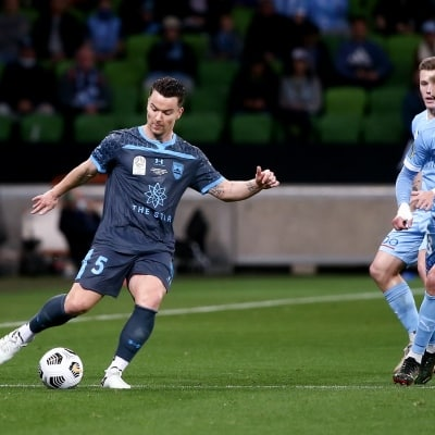 MELBOURNE, AUSTRALIA - JUNE 27: Alex Baumjohann of Sydney FC kicks the ball during the A-League Grand-Final soccer match between Melbourne City FC and Sydney FC on June 27, 2021 at AAMI Park in Melbourne, Australia. (Photo by Dave Hewison/Speed Media)