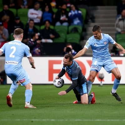MELBOURNE, AUSTRALIA - JUNE 27: Adam Le Fondre of Sydney FC goes down during the A-League Grand-Final soccer match between Melbourne City FC and Sydney FC on June 27, 2021 at AAMI Park in Melbourne, Australia. (Photo by Dave Hewison/Speed Media)