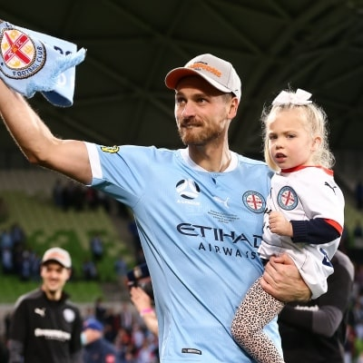 MELBOURNE, AUSTRALIA - JUNE 27: Rostyn Griffiths of Melbourne City carries his daughter onto the field during the A-League Grand-Final soccer match between Melbourne City FC and Sydney FC on June 27, 2021 at AAMI Park in Melbourne, Australia. (Photo by Dave Hewison/Speed Media)