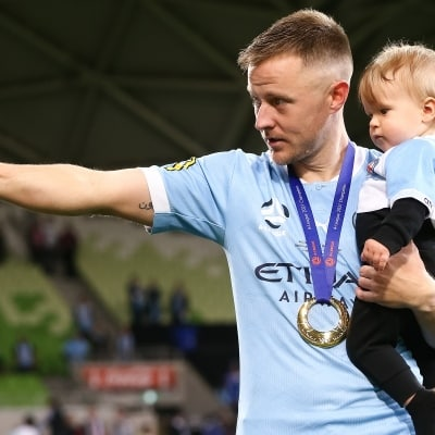 MELBOURNE, AUSTRALIA - JUNE 27: Scott Jamieson of Melbourne City carries his son onto the field during the A-League Grand-Final soccer match between Melbourne City FC and Sydney FC on June 27, 2021 at AAMI Park in Melbourne, Australia. (Photo by Dave Hewison/Speed Media)