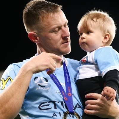 MELBOURNE, AUSTRALIA - JUNE 27: Scott Jamieson of Melbourne City takes his kid onto the field during the A-League Grand-Final soccer match between Melbourne City FC and Sydney FC on June 27, 2021 at AAMI Park in Melbourne, Australia. (Photo by Dave Hewison/Speed Media)MELBOURNE, AUSTRALIA - JUNE 27: during the A-League Grand-Final soccer match between Melbourne City FC and Sydney FC on June 27, 2021 at AAMI Park in Melbourne, Australia. (Photo by Dave Hewison/Speed Media)