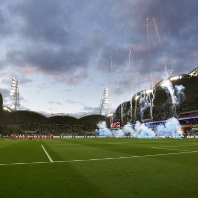 MELBOURNE, AUSTRALIA - JUNE 27: Players walk onto the field as flanked by fireworks during the A-League Grand-Final soccer match between Melbourne City FC and Sydney FC on June 27, 2021 at AAMI Park in Melbourne, Australia. (Photo by Dave Hewison/Speed Media)