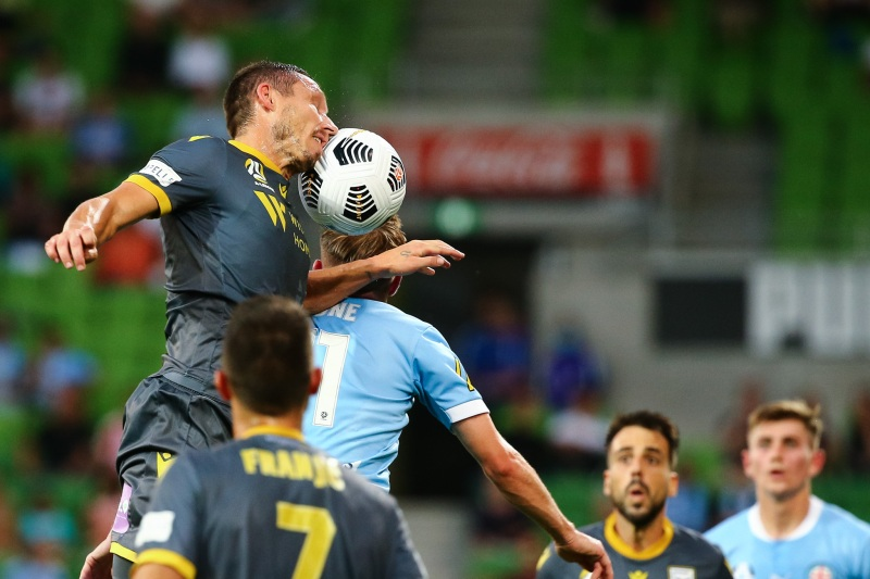 MELBOURNE, AUSTRALIA - MARCH 12: Mark Milligan of Macarthur FC heads the ball during the Hyundai A-League soccer match between Melbourne City FC and Macarthur FC on March 12, 2021 at AAMI Park in Melbourne, Australia. (Photo by Speed Media/Icon Sportswire)