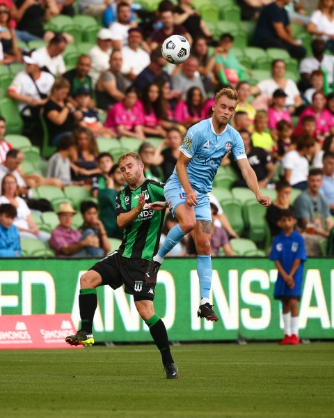 MELBOURNE, AUSTRALIA - APRIL 1: Nathaniel Atkinson of Melbourne City heads the ball ahead of Connor Pain of Western United during the Hyundai A-League soccer match between Western United FC and Melbourne City FC on April 1, 2021 at AAMI Park in Melbourne, Australia. (Photo by Speed Media/Icon Sportswire)
