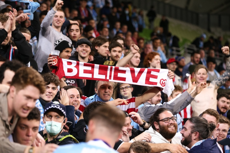 MELBOURNE, AUSTRALIA - JUNE 27: A fan holds up a scarf with with 'believe' printed across it during the A-League Grand-Final soccer match between Melbourne City FC and Sydney FC on June 27, 2021 at AAMI Park in Melbourne, Australia. (Photo by Dave Hewison/Speed Media/Icon Sportswire)