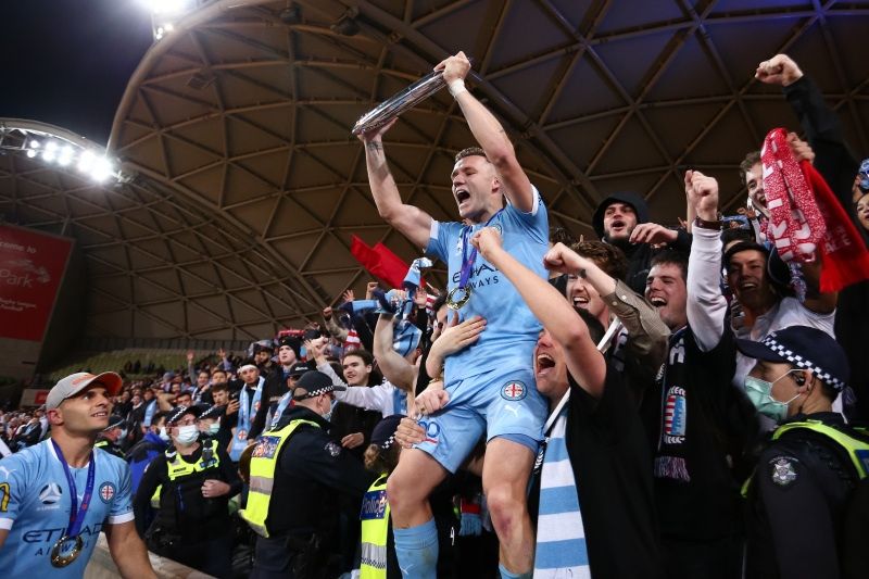 MELBOURNE, AUSTRALIA - JUNE 27: Scott Galloway of Melbourne City tans with their fans during the A-League Grand-Final soccer match between Melbourne City FC and Sydney FC on June 27, 2021 at AAMI Park in Melbourne, Australia. (Photo by Dave Hewison/Speed Media/Icon Sportswire)