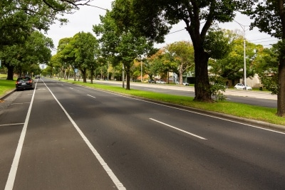 Melbourne, Australia, 12 April, 2020. Usually highly congested, Flemington Road remains empty during the  COVID-19 Crisis in Melbourne, Phillip Island Circuit, Australia. Credit: Dave Hewison/Alamy Live News