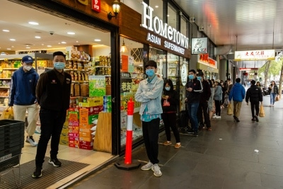 Supermarkets are limiting how many customers are allowed in their stores at any one time, shoppers now must queue at the entrance and wait to be ushered in due to COVID 19 on 12 April, 2020 in Melbourne, Australia. (Photo by Speed Media/Icon Sportswire)