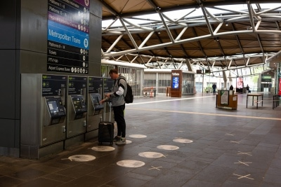 Melbourne, Australia, 12 April, 2020. Southern Cross Railway Station, Melbourne's busiest interchange, remains empty except for one single passenger paying for a ticket during the  COVID-19 Crisis in Melbourne, Phillip Island Circuit, Australia. Credit: Dave Hewison/Alamy Live News