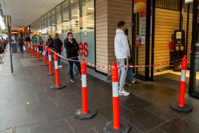 Shoppers queue outside of a supermarket on Chapel Street due to COVID 19 on 12 April, 2020 in Melbourne, Australia. (Photo by Speed Media/Icon Sportswire)