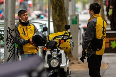 Food delivery riders in the CBD incorrectly wearing facemasks amid calls to stop wearing them by the federal government during COVID 19 on 12 April, 2020 in Melbourne, Australia. (Photo by Speed Media/Icon Sportswire)