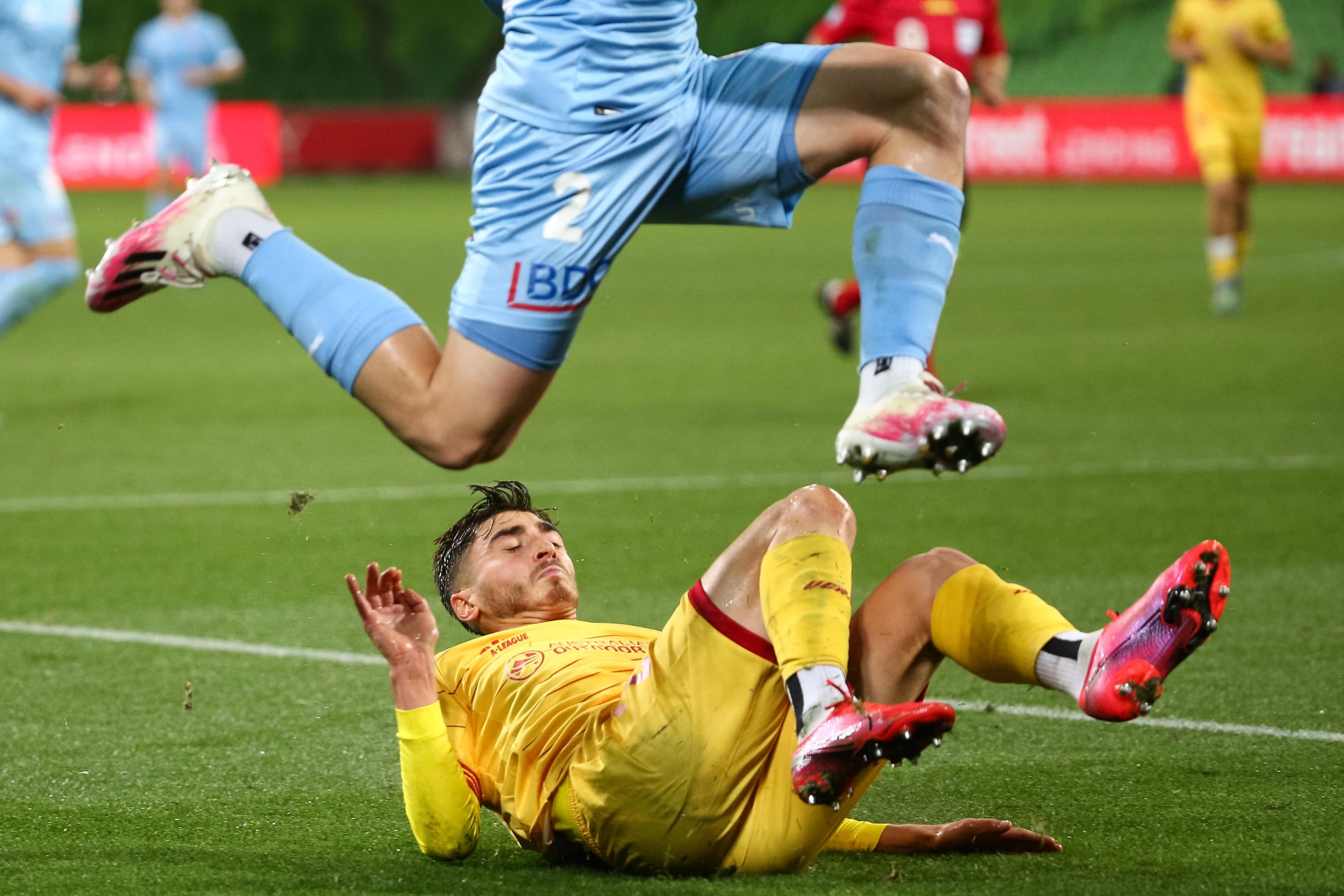 MELBOURNE, AUSTRALIA - MAY 13: Joshua Cavallo of Adelaide United takes a fall as Scott Galloway of Melbourne City controls the ball during the Hyundai A-League soccer match between Melbourne City FC and Adelaide United on May 13, 2021 at AAMI Park in Melbourne, Australia. (Photo by Speed Media/Icon Sportswire)