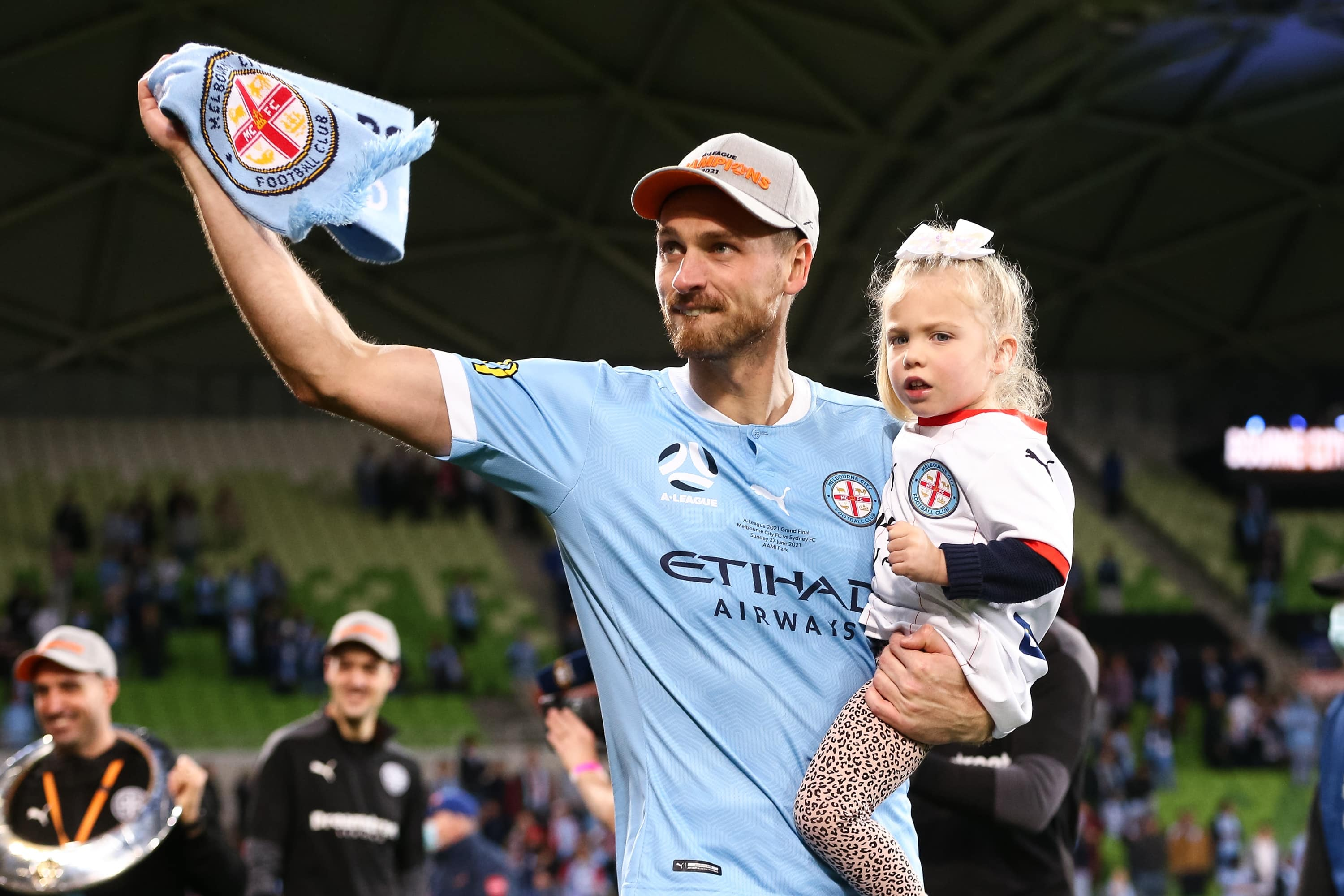 MELBOURNE, AUSTRALIA - JUNE 27: Rostyn Griffiths of Melbourne City carries his daughter onto the field during the A-League Grand-Final soccer match between Melbourne City FC and Sydney FC on June 27, 2021 at AAMI Park in Melbourne, Australia. (Photo by Dave Hewison/Speed Media/Icon Sportswire)