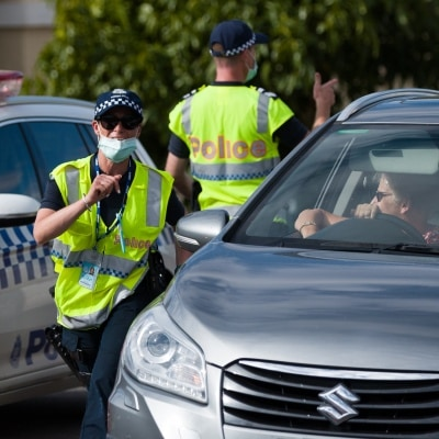 Police check permits as Victorian rush to beat the border closures after being given almost no notice to return home during COVID-19 in Victoria, Australia. With only 11 active cases in Victoria, the Andrews Government's Contact Tracing System is so ineffective, borders have had to be shut causing chaos to thousands of holiday makers lives and further pain to already struggling businesses.