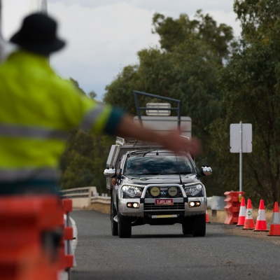 A Parks Victoria Officer motions a car to stop to have their permits checked during COVID-19 in Victoria, Australia. With only 11 active cases in Victoria, the Andrews Government's Contact Tracing System is so ineffective, borders have had to be shut causing chaos to thousands of holiday makers lives and further pain to already struggling businesses.