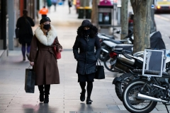 Two woman are seen wearing facemasks as they walk in the CBD during COVID-19 in Melbourne, Australia. Victoria has recorded 21 additional COVID related deaths and 410 new cases, marking its deadliest day since the pandemic began.