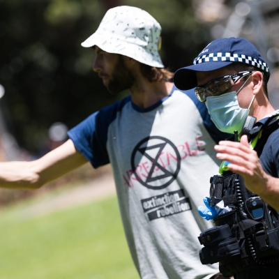 Police worked closely with the protesters during an Extinction Rebellion protest in Melbourne.  A small group of climate protesters marched from Flagstaff Gardens to The Queen Victoria Market and ending with two individuals gluing themselves together, and then glued themselves to Victoria Avenue outside of the Market. This comes as 5 new COVID-19 cases were uncovered in Melbourne's revamped Hotel Quarantine, breaking almost 40 days of virus free days.