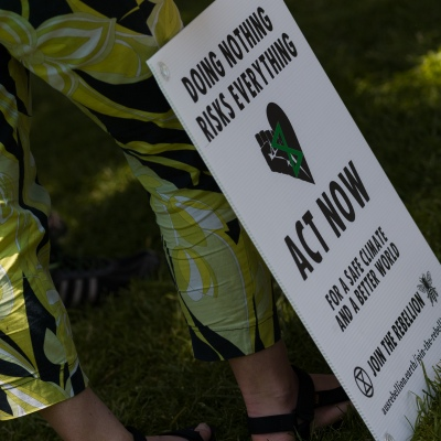 A placard is seen during an Extinction Rebellion protest in Melbourne.  A small group of climate protesters marched from Flagstaff Gardens to The Queen Victoria Market and ending with two individuals gluing themselves together, and then glued themselves to Victoria Avenue outside of the Market. This comes as 5 new COVID-19 cases were uncovered in Melbourne's revamped Hotel Quarantine, breaking almost 40 days of virus free days.