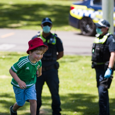 A little boy makes a run for it as police look on during an Extinction Rebellion protest in Melbourne.  A small group of climate protesters marched from Flagstaff Gardens to The Queen Victoria Market and ending with two individuals gluing themselves together, and then glued themselves to Victoria Avenue outside of the Market. This comes as 5 new COVID-19 cases were uncovered in Melbourne's revamped Hotel Quarantine, breaking almost 40 days of virus free days.