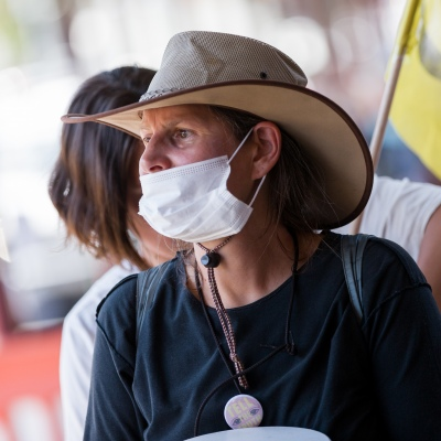A protester is seen wearing a facemask during an Extinction Rebellion protest in Melbourne.  A small group of climate protesters marched from Flagstaff Gardens to The Queen Victoria Market and ending with two individuals gluing themselves together, and then glued themselves to Victoria Avenue outside of the Market. This comes as 5 new COVID-19 cases were uncovered in Melbourne's revamped Hotel Quarantine, breaking almost 40 days of virus free days.