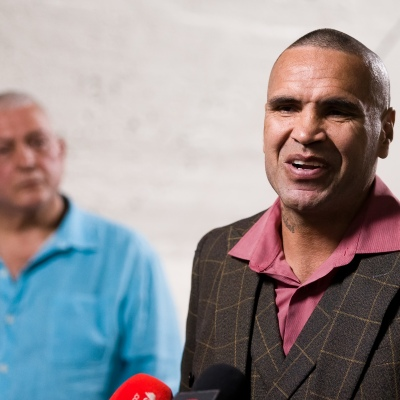 MELBOURNE, AUSTRALIA - DECEMBER 18: Anthony Mundine (R) speaks to the press as Mick Gatto (L)  looks on in the background during the press conference to announce the upcoming fight between Anthony Mundine and Michael Zerafa at Doherty's City Gym on December 18, 2020 in Melbourne, Australia. (Photo by Dave Hewison/Speed Media/Icon Sportswire)