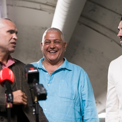 MELBOURNE, AUSTRALIA - DECEMBER 18: Mick Gatto (C) is seen laughing as he introduces Anthony Mundine (L) and Michael Zerafa (R) to the press during the press conference to announce the upcoming fight between Anthony Mundine and Michael Zerafa at Doherty's City Gym on December 18, 2020 in Melbourne, Australia. (Photo by Dave Hewison/Speed Media/Icon Sportswire)