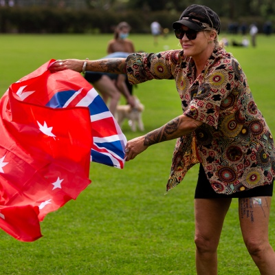 MELBOURNE, VIC - SEPTEMBER 19:  woman flies the Red Ensign Australian Flag during the Freedom protest on September 19, 2020 in Melbourne, Australia. Freedom protests are being held in Melbourne every Saturday and Sunday in response to the governments COVID-19 restrictions and continuing removal of liberties despite new cases being on the decline. Victoria recorded a further 21 new cases overnight along with 7 deaths. (Photo by Speed Media/Icon Sportswire)