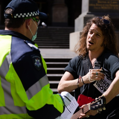 MELBOURNE, VIC - SEPTEMBER 19: A freedom protester speaks to police at the State Library during the Freedom protest on September 19, 2020 in Melbourne, Australia. Freedom protests are being held in Melbourne every Saturday and Sunday in response to the governments COVID-19 restrictions and continuing removal of liberties despite new cases being on the decline. Victoria recorded a further 21 new cases overnight along with 7 deaths. (Photo by Speed Media/Icon Sportswire)