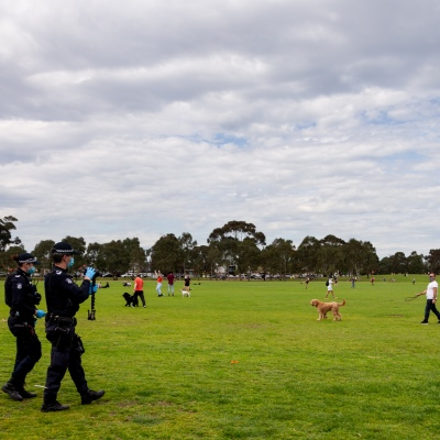 MELBOURNE, VIC - SEPTEMBER 19: Police film at Elsternwick Park as protesters show up for an anti lockdown rally during the Freedom protest on September 19, 2020 in Melbourne, Australia. Freedom protests are being held in Melbourne every Saturday and Sunday in response to the governments COVID-19 restrictions and continuing removal of liberties despite new cases being on the decline. Victoria recorded a further 21 new cases overnight along with 7 deaths. (Photo by Speed Media/Icon Sportswire)