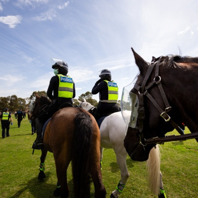 MELBOURNE, VIC - SEPTEMBER 19: Mounted Police walk through the Elsternwick park as they push protesters back during the Freedom protest on September 19, 2020 in Melbourne, Australia. Freedom protests are being held in Melbourne every Saturday and Sunday in response to the governments COVID-19 restrictions and continuing removal of liberties despite new cases being on the decline. Victoria recorded a further 21 new cases overnight along with 7 deaths. (Photo by Speed Media/Icon Sportswire)