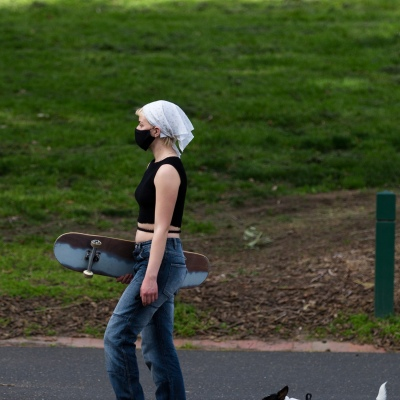 A girl is seen with a skateboard as her dog in the grounds of the MCG as an announcement was made today by the AFL CEO, Gillon McLachlan that the 2020 Grand Final will be held in Brisbane due to Daniel Andrews draconian rules in Victoria during COVID-19 in Melbourne, Australia.  Premier Daniel Andrews Labor Government was given a six month extension to their State of Emergency Powers. Under these powers, the government need not justify their response to the pandemic or have to face any scrutiny. It risks the continuation of major events in Victoria and will plunge the state into the deepest recession not seen in 100 years. The government continues to push the meaningless daily case numbers as daily deaths continue to plunge as Aged Care is brought under control.