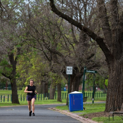 A woman is seen jogging in Yarra Park near the MCG as an announcement was made today by the AFL CEO, Gillon McLachlan that the 2020 Grand Final will be held in Brisbane due to Daniel Andrews draconian rules in Victoria during COVID-19 in Melbourne, Australia.  Premier Daniel Andrews Labor Government was given a six month extension to their State of Emergency Powers. Under these powers, the government need not justify their response to the pandemic or have to face any scrutiny. It risks the continuation of major events in Victoria and will plunge the state into the deepest recession not seen in 100 years. The government continues to push the meaningless daily case numbers as daily deaths continue to plunge as Aged Care is brought under control.