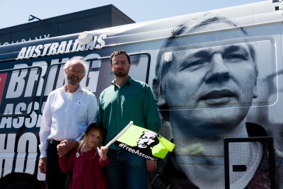 """Melbourne, Australia, 20 December, 2020.  Julian Assange's Father, John Shipton (l) and his half Brother, Gabriel Shipton (r), pose in front of an Assange campaign awareness van before setting of on a convoy through Melbourneduring the Bring Julian Assange Home Rally on December 20, 2020 in Melbourne, Australia. On 4 January, a British judge is set to rule on whether Julian Assange should be extradited to the United States, where he could face a 175-year sentence in a high-security """"supermax"""" prison. Credit: Dave Hewison/Alamy Live News"""