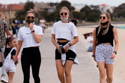 Three young girls walk together in St Kilda during the final days of the worlds toughest and longest COVID-19 restrictions in St Kilda.  With 21 days of zero new cases, Premier Daniel Andrews is expected to announce major easing of restrictions, including masks, at his press conference on Sunday.