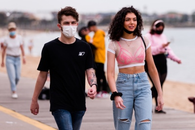 A couple walk together in St Kilda Beach during the final days of the worlds toughest and longest COVID-19 restrictions in St Kilda.  With 21 days of zero new cases, Premier Daniel Andrews is expected to announce major easing of restrictions, including masks, at his press conference on Sunday.