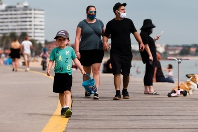 A young boy plays on the foreshore during the final days of the worlds toughest and longest COVID-19 restrictions in St Kilda.  With 21 days of zero new cases, Premier Daniel Andrews is expected to announce major easing of restrictions, including masks, at his press conference on Sunday.