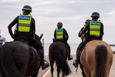 Officers from the Mounted Branch of Victoria Police on patrol during the final days of the worlds toughest and longest COVID-19 restrictions in St Kilda.  With 21 days of zero new cases, Premier Daniel Andrews is expected to announce major easing of restrictions, including masks, at his press conference on Sunday.