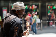 A busker is seen performing the Blues on Bourke Street Mall during Black Friday sales in the CBD.  As temperatures soured in Melbourne, locals flock to the city for Christmas bargains. Victoria saw its 29th day of no cases today but despite this the government show no signs of further lifting of restrictions.