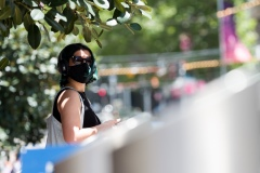 A woman is seen standing on Bourke Street Mall during Black Friday sales in the CBD.  As temperatures soured in Melbourne, locals flock to the city for Christmas bargains. Victoria saw its 29th day of no cases today but despite this the government show no signs of further lifting of restrictions.