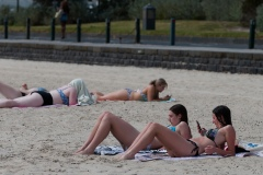 Friends are seen sunbaking on the beach during Melbourne's first heatwave in months.  As temperatures soured in Melbourne, locals flock to the beach in their thousands to escape the heat. Victoria saw its 29th day of no cases today but despite this the government show no signs of further lifting of restrictions.