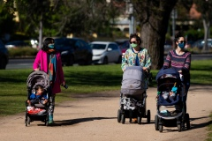 Young mothers enjoy the sunshine with their babies in Princes Park during COVID-19 in Melbourne, Australia. Victoria records 5 new cases and three deaths as restrictions are slightly eased. This comes just days after Health Minister Jenny Mikakos resigned over the Hotel Quarantine bungle and as pressure mounts for the Premier, Daniel Andrews, to resign. As the Spring weather sees warmer days, more Melbournians are simply ignoring the rules.