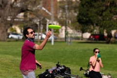 A man catches a Frisbee during COVID-19 in Melbourne, Australia. Victoria records 5 new cases and three deaths as restrictions are slightly eased. This comes just days after Health Minister Jenny Mikakos resigned over the Hotel Quarantine bungle and as pressure mounts for the Premier, Daniel Andrews, to resign. As the Spring weather sees warmer days, more Melbournians are simply ignoring the rules.