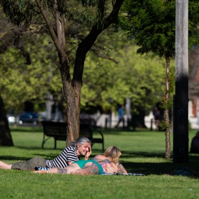 A couple are seen lying on the grass enjoying the spring weather in Princes Park during COVID-19 in Melbourne, Australia. Victoria records 5 new cases and three deaths as restrictions are slightly eased. This comes just days after Health Minister Jenny Mikakos resigned over the Hotel Quarantine bungle and as pressure mounts for the Premier, Daniel Andrews, to resign. As the Spring weather sees warmer days, more Melbournians are simply ignoring the rules.