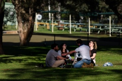 A group of friends are seen laughing in Princes Park during COVID-19 in Melbourne, Australia. Victoria records 5 new cases and three deaths as restrictions are slightly eased. This comes just days after Health Minister Jenny Mikakos resigned over the Hotel Quarantine bungle and as pressure mounts for the Premier, Daniel Andrews, to resign. As the Spring weather sees warmer days, more Melbournians are simply ignoring the rules.